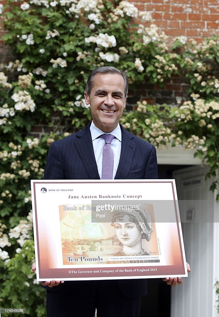 Governor of the Bank of England, <a gi-track='captionPersonalityLinkClicked' href=/galleries/search?phrase=Mark+Carney&family=editorial&specificpeople=3028157 ng-click='$event.stopPropagation()'>Mark Carney</a> stands holding the concept design for the new Bank of England ten pound banknote, featuring author Jane Austen, following the presentation at the Jane Austen House Museum on July 24, 2013 in Chawton, near Alton, England. Jane Austen will appear on the United Kingdom's next 10 pound note, ensuring at least one female figure is represented on the currency in circulation.