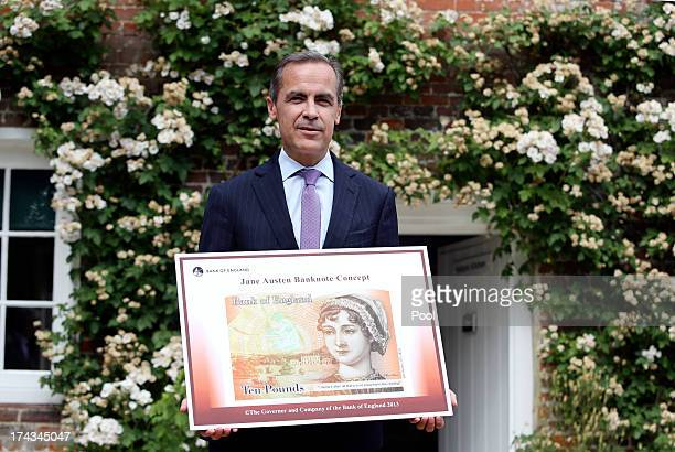 Governor of the Bank of England Mark Carney stands holding the concept design for the new Bank of England ten pound banknote featuring author Jane...