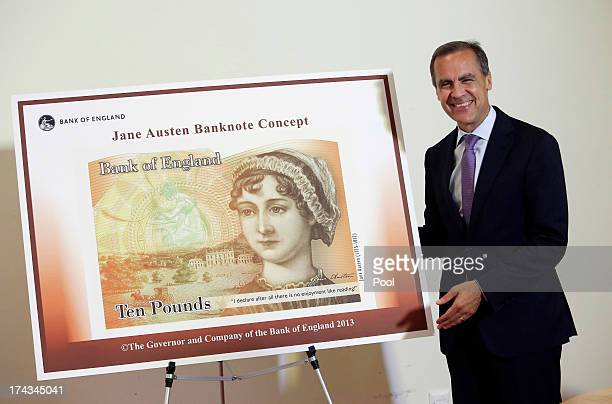 Governor of the Bank of England Mark Carneystands alongside the concept design for the new Bank of England ten pound banknote featuring author Jane...