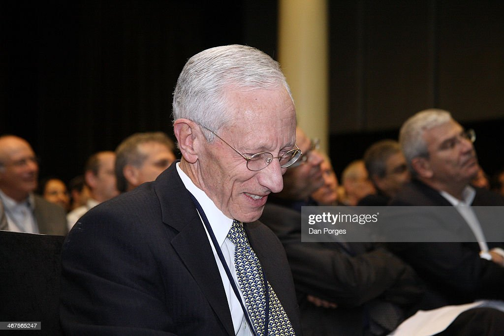 Governor of the Bank of Israel Professor <a gi-track='captionPersonalityLinkClicked' href=/galleries/search?phrase=Stanley+Fischer&family=editorial&specificpeople=233518 ng-click='$event.stopPropagation()'>Stanley Fischer</a> smiles as he reads a document at an unspecified event, Tel Aviv, Israel, March 18, 2010.