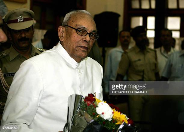 Governor of the Indian state of Karnataka Rameswar Thakur holds a floral bouquet prior to attending a meeting at The Vidhan Soudha in Bangalore 12...