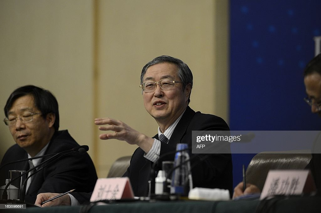 Governor of the People's Bank of China, Zhou Xiaochuan answers questions during a press conference in the first session of the 12th National People's Congress (NPC) in Beijing on March 13, 2013. Thousands of delegates from across China meet this week to seal a power transfer to new leaders whose first months running the Communist Party have pumped up expectations with a deluge of propaganda.
