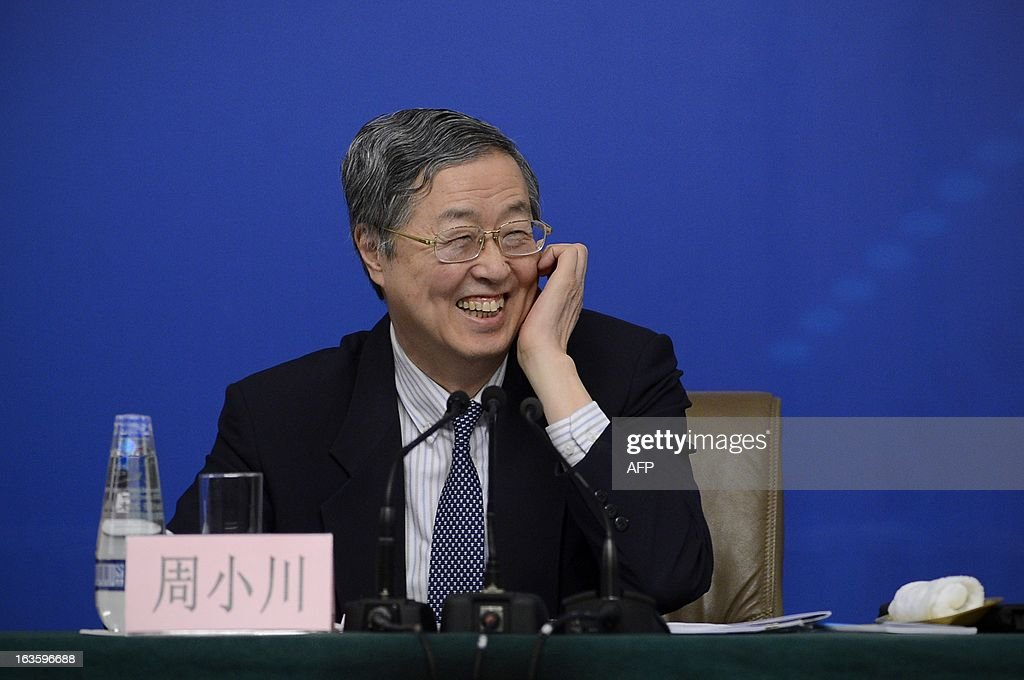 Governor of the People's Bank of China, Zhou Xiaochuan smiles during a press conference in the first session of the 12th National People's Congress (NPC) in Beijing on March 13, 2013. Thousands of delegates from across China meet this week to seal a power transfer to new leaders whose first months running the Communist Party have pumped up expectations with a deluge of propaganda.