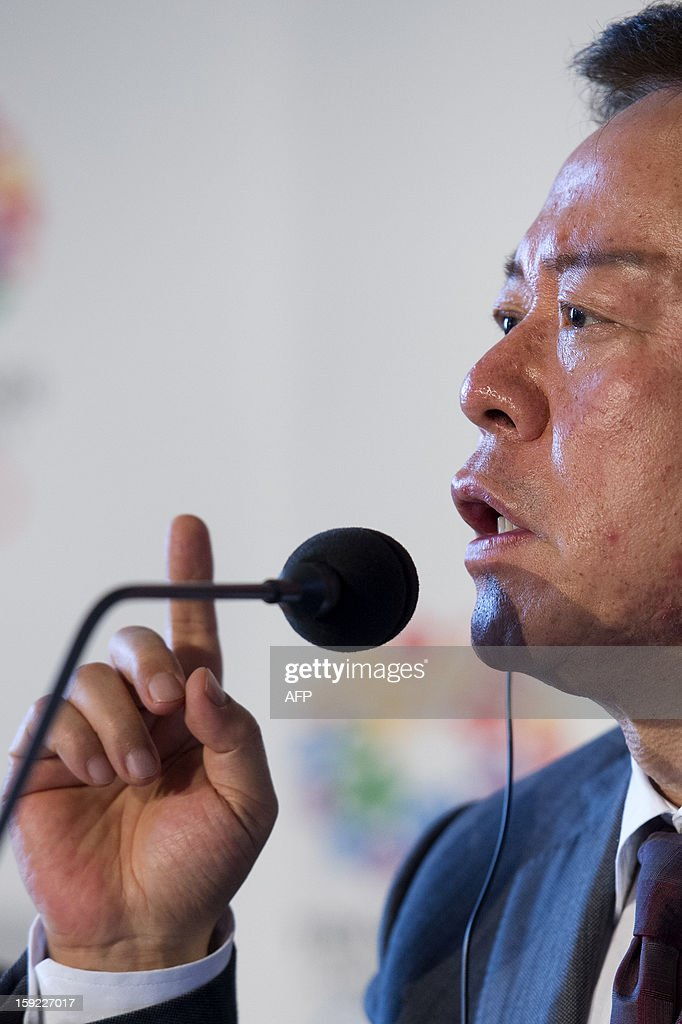 Governor of Tokyo and Tokyo 2020 Chairman Naoki Inose (R) speaks during a press conference in London on January 10, 2013 to launch their candidature file for the 2020 Olympic and Paralympic Games. Tokyo is bidding to host its first Summer Olympics since the 1964 Games. The plan features a 'compact' and 'dynamic' Olympics based on Tokyo's financial wealth and track record in hosting international sports events. It also aims to allay fears of damage from a big earthquake or radiation from the 2011 Fukushima nuclear disaster. AFP PHOTO/BEN STANSALL