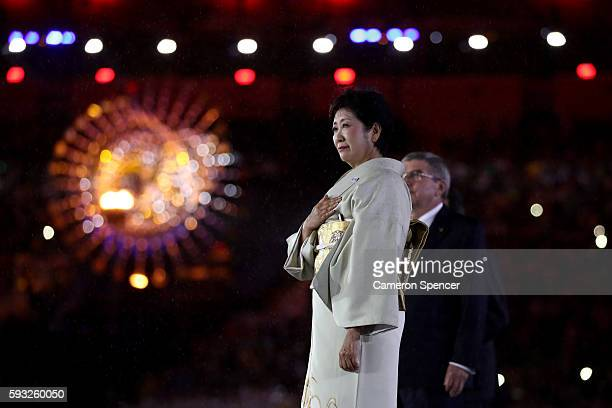 Governor of Tokyo Yuriko Koike and IOC President Thomas Bach take part in the Flag Handover Ceremony during the Closing Ceremony on Day 16 of the Rio...