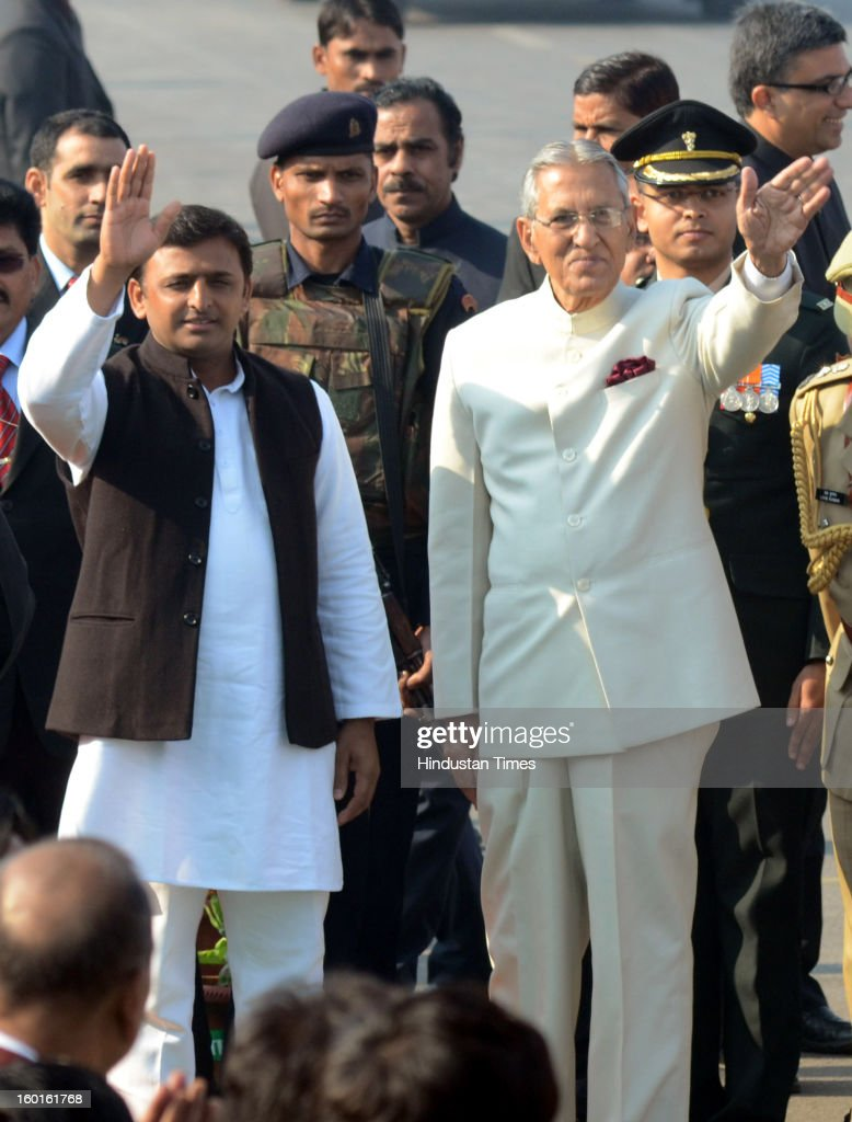 Governor of UP B.L Joshi and Chief Minister Akhilesh Yadav wave their hands during the Republic Day Parade at Vidhan Bhavan on January 26, 2013 in Lucknow, India. India marked its Republic Day with celebrations held under heavy security, especially in New Delhi where large areas were sealed off for an annual parade of military hardware.