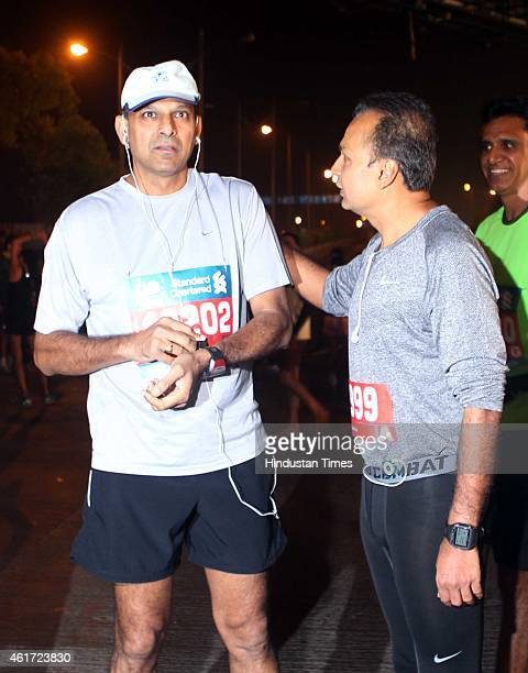 Governor Raghuram Rajan and Industrialist Anil Ambani participate during the 12th edition of the Standard Chartered Mumbai Marathon 2015 on January...