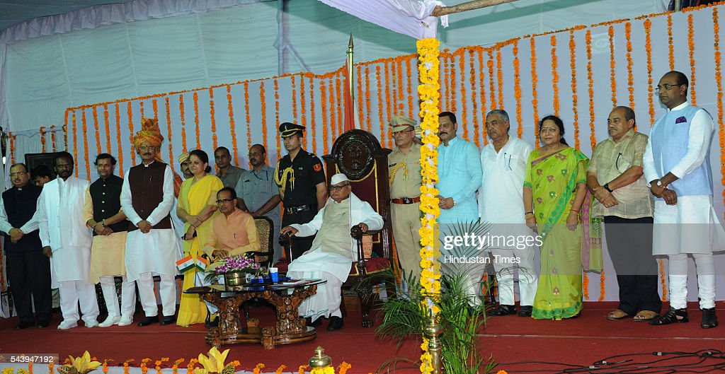 Governor Ram Naresh Yadav and Chief minister Shivraj Singh Chouhan along with New ministers after the Oath ceremony at Raj Bhavan on June 30, 2016 in Bhopal, India. Madhya Pradesh Chief Minister Shivraj Singh Chouhan expanded his cabinet inducting nine new ministers, four of cabinet rank and five ministers of state.