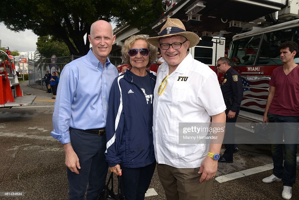Governor Rick Scott and Mark B. Rosenberg participates in Three Kings Parade in Miami's Little Havana on January 11, 2015 in Miami, Florida.