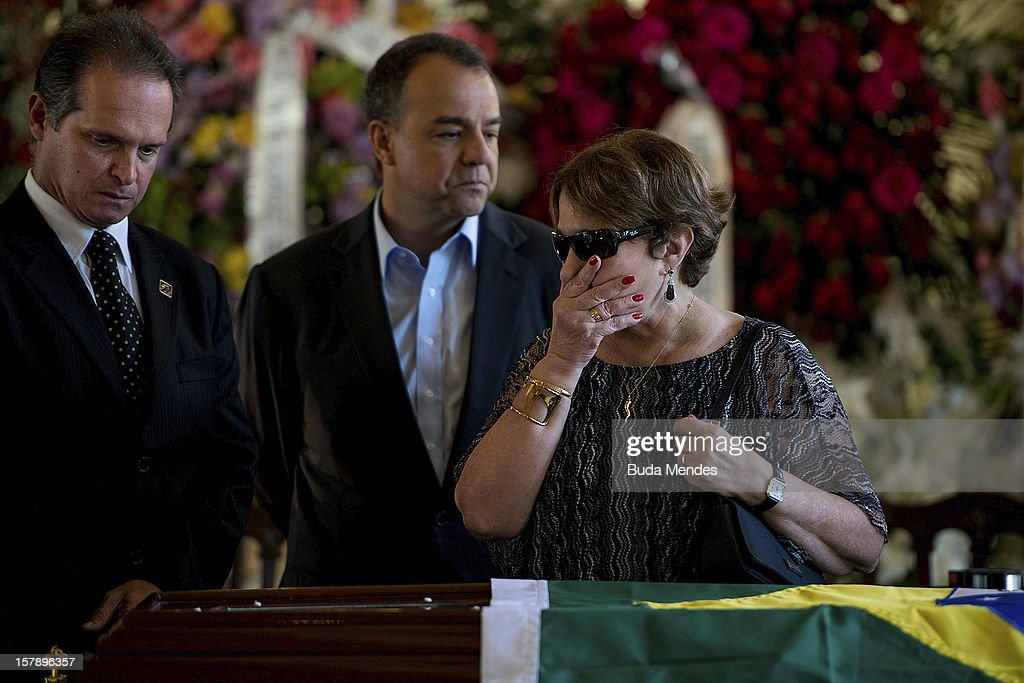 Governor Sergio Cabral accompanies the widow Vera Lœcia Niemeyer during the funeral of the Architect Oscar Niemeyer at Palacio City on December 07, 2012 in Rio de Janeiro, Brazil. Niemeyer was hospitalized for 33 days at Samarian Hospital and died at 104 years old due to a kidney infection on December 06, 2012 in Rio de Janeiro, Brazil.