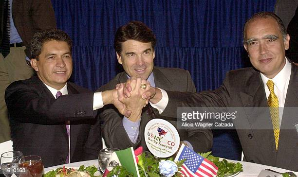 Governor Tomas Yarrington of the state of Tamaulipas Mexico Texas Governor Rick Perry and Nuevo Leon Governor Fernando Canales Clariond join hands in...