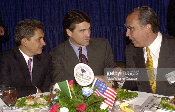 Governor Tomas Yarrington of the state of Tamaulipas Mexico Texas Governor Rick Perry and Nuevo Leon Governor Fernando Canales Clariond speak with...