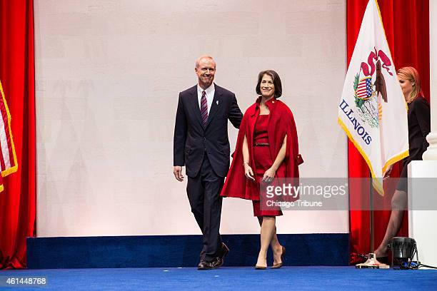 Governorelect Bruce Rauner steps onto the stage to be sworn into office at the Prairie Capital Convention Center on Monday Jan 12 2015 in Springfield...