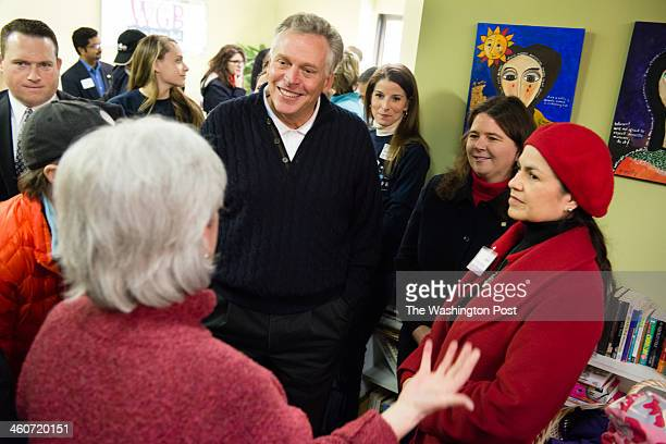 Governorelect Terry McAuliffe center along with his wife Dorothy McAuliffe three of their children Dori Mary and Peter attended a volunteer event at...