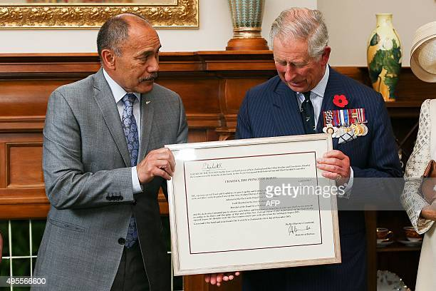 GovernorGeneral Jerry Mateparae presents Britain's Prince Charles with his new Military Warrants at Government House in Wellington on November 4 2015...