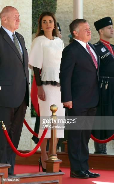 GovernorGeneral of Australia Peter Cosgrove Jordanian King Abdullah II and Queen Rania review the honour guard during a welcome ceremony at the Royal...