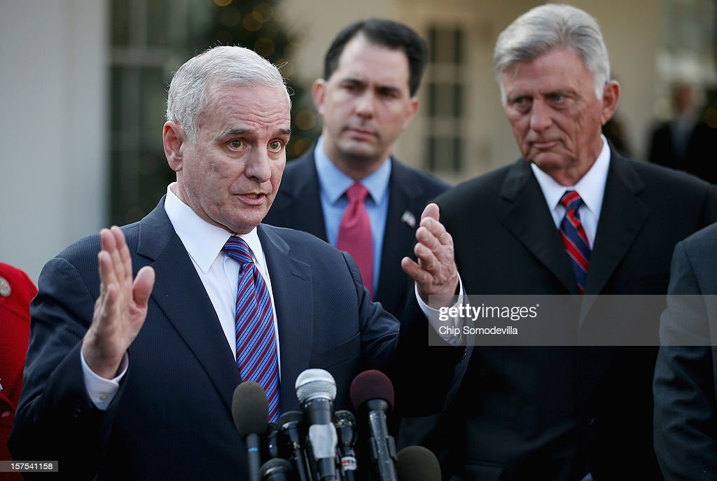 U.S. Governors Association Executive Committee members (L-R) Minnesota Gov. <a gi-track='captionPersonalityLinkClicked' href=/galleries/search?phrase=Mark+Dayton&family=editorial&specificpeople=612750 ng-click='$event.stopPropagation()'>Mark Dayton</a>, Wisconsin Gov. <a gi-track='captionPersonalityLinkClicked' href=/galleries/search?phrase=Scott+Walker+-+Politician&family=editorial&specificpeople=7511934 ng-click='$event.stopPropagation()'>Scott Walker</a> and Arkansas Gov. Mike Beebe talk to reporters after meeting with President Barack Obama at the White House December 4, 2012 in Washington, DC. The bipartisan group of governors met with the president to discuss the 'fiscal cliff' and are now headed to Capitol Hill to meet with Speaker of the House John Boehner (R-OH).