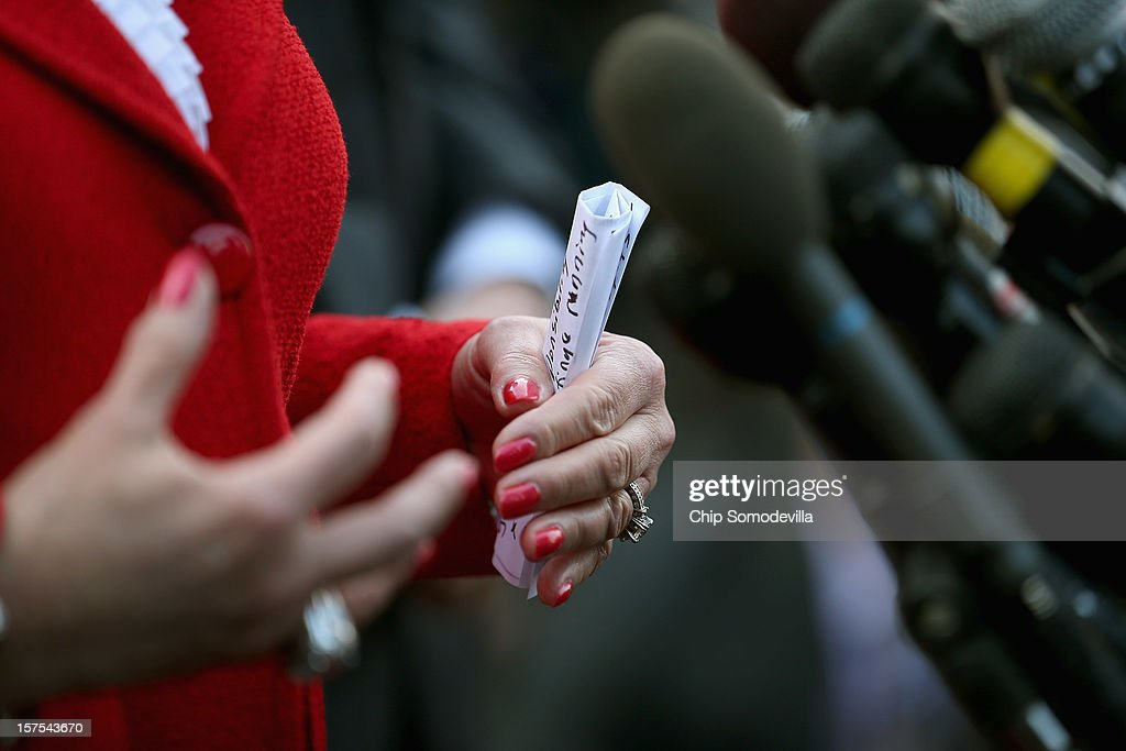 U.S. Governors Association Executive Committee Vice Chair Oklahoma Gov. Mary Fallin holds rolled up notes in her hand as she talks to reporters after the committee met with President Barack Obama at the White House December 4, 2012 in Washington, DC. The bipartisan group of governors met with the president to discuss the 'fiscal cliff' and are now headed to Capitol Hill to meet with Speaker of the House John Boehner (R-OH).