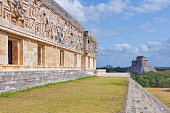 The Governor's Palace, a long low building atop a huge platform, with the longest façades in Pre-Columbian Mesoamerica. From a small platform with a stone throne with two jaguar heads, this edifice wo