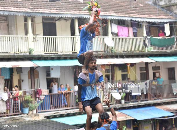 Govinda breaking Dahi Handi on the occasion of Gokulashtami at Prabhadevi on August 15 2017 in Mumbai India The childgod Krishna and his friends used...