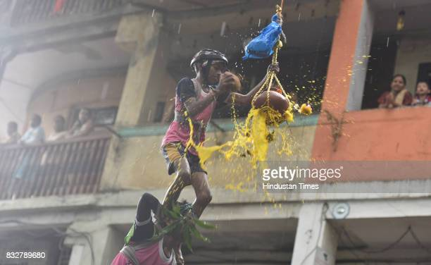 Govinda revellers form human pyramid to break earthen pot on the occasion of Gokulashtami at Prabhadevi on August 15 2017 in Mumbai India The...