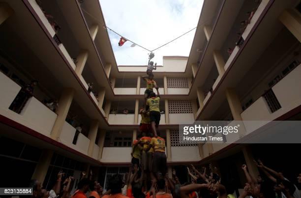 Govinda revellers of Lower Parel make a human pyramid on ocassion of Gokulasthami at Rameshwar Prasad CHS at Prabhadevi on Monday in Mumbai