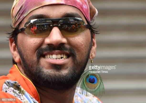 Govinda revellers use Peacock features ear ring on the occasion of Gokulashtami at Prabhadevi on August 15 2017 in Mumbai India The childgod Krishna...