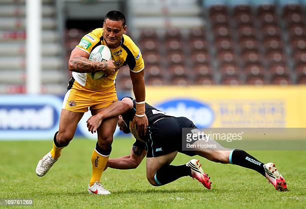 Weller Hauraki of Castleford is tackled by Craig Gower of London Broncos during the Super League match between London Broncos and Castleford Tigers...