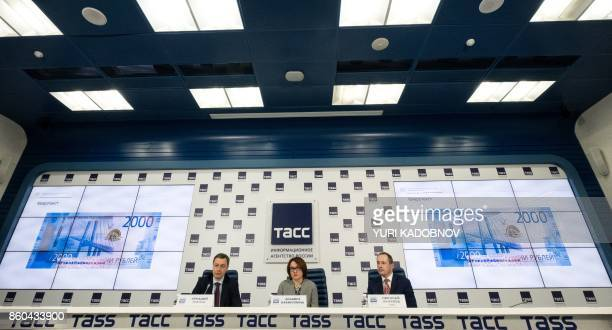 Goznak general director Arkady Trachuk and Russia's Central bank chief Elvira Nabiullina attend a presentation of the new 200 and 2000 ruble...