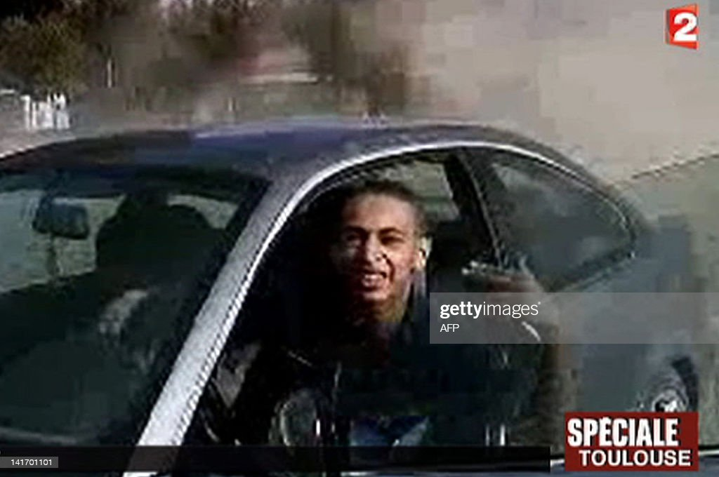 A TV grab released by French TV France 2 shows an image of 23-year-old Frenchman of Algerian descent Mohamed Merah, suspected of a series of deadly shootings in Toulouse and Montauban which killed seven persons, including three children. Merah, suspected of calmly shooting dead three children and a teacher at a Toulouse Jewish school as well as three French paratroopers in two other attacks, is holed up in his besieged flat that RAID police special forces tried to storm in the French southern city of Toulouse.