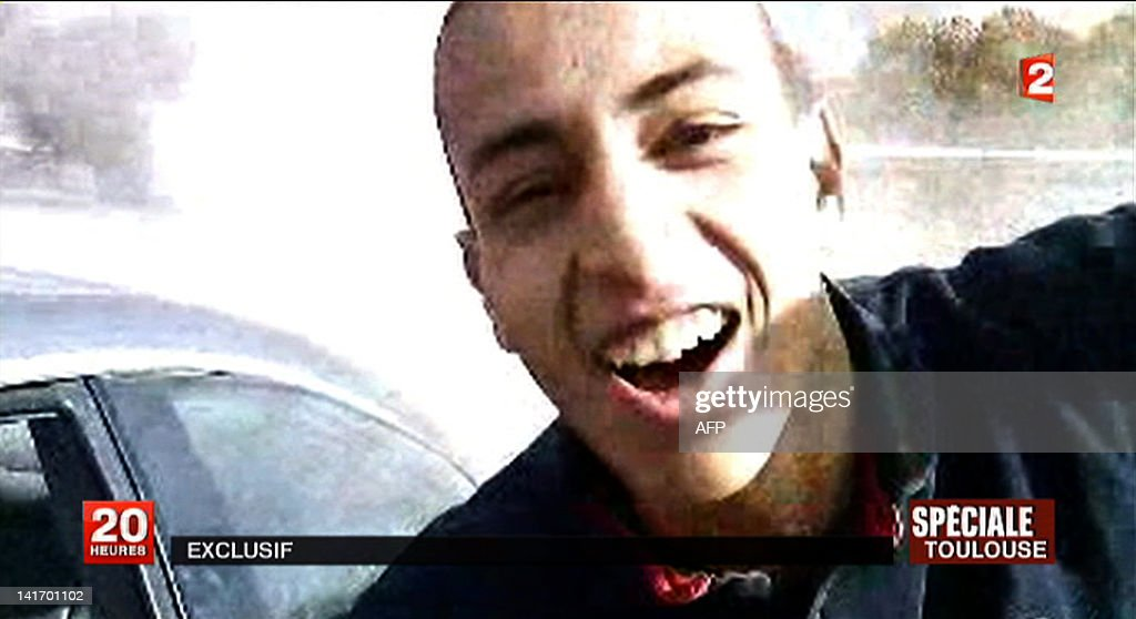 A TV grab released by French TV France 2 shows an image of 23-year-old Frenchman of Algerian descent Mohamed Merah, suspected of a series of deadly shootings in Toulouse and Montauban which killed seven persons, including three children. Merah, suspected of calmly shooting dead three children and a teacher at a Toulouse Jewish school as well as three French paratroopers in two other attacks, is holed up in his besieged flat that RAID police special forces tried to storm in the French southern city of Toulouse. AFP PHOTO / FRANCE 2