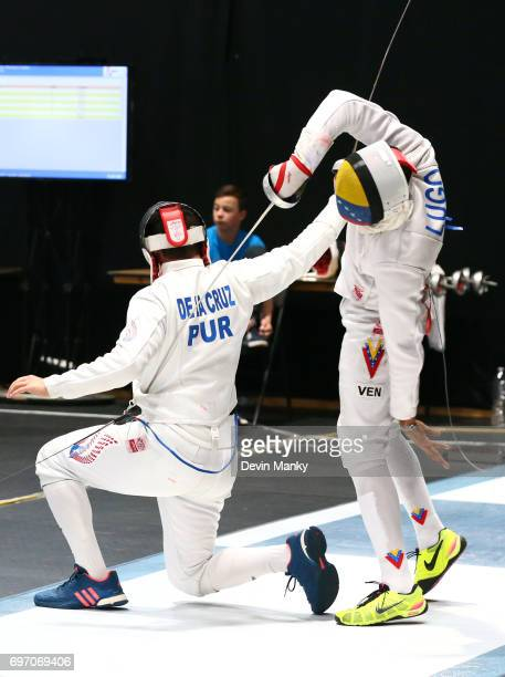 Grabiel Lugo of Venezuela makes a touch to the back of Jean De La Cruz of Puerto Rico during the Team Men's Epee event on June 17 2017 at the...
