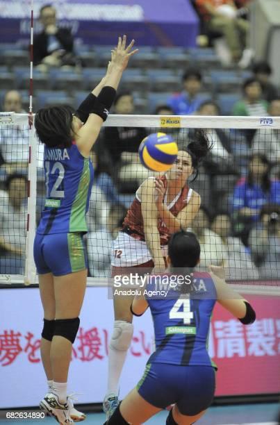 Grabiela de Souza of Osasco Voleibol Clube in action against Yuka Imamura and Nana Iwasaka of Hisamitsu Spring during the semifinals match of the...