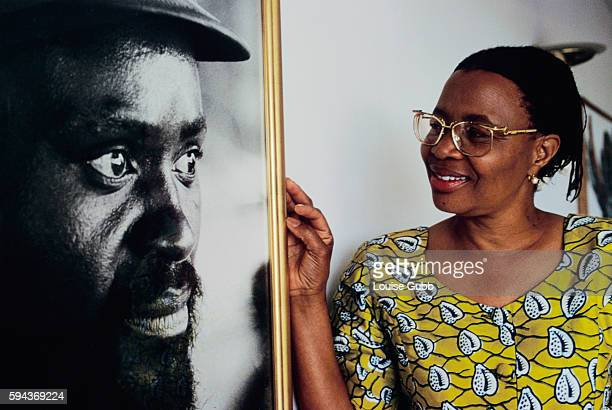 Graca Machel looking at a large photograph of her late husband Samora Machel the first president of Mozambique