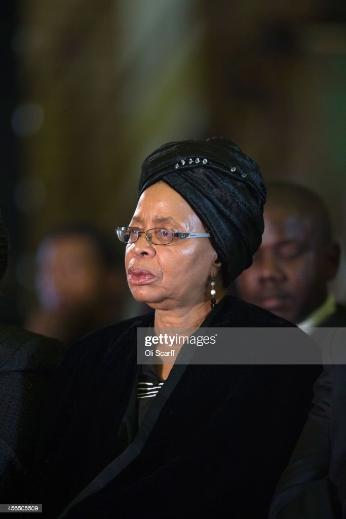 Graca Machel, the widow of Nelson Mandela, attends an African National Congress (ANC) led alliance send off ceremony for former South African President Nelson Mandela at Waterkloof military airbase on December 14, 2013 in Pretoria, South Africa. The ANC held an official send off ceremony as the body of former South African President prepares to make one final journey to his hometown of Qunu for burial. Mr. Mandela passed away on the evening of December 5, 2013 at his home in Houghton at the age of 95. Mandela became South Africa's first black president in 1994 after spending 27 years in jail for his activism against apartheid in a racially-divided South Africa.
