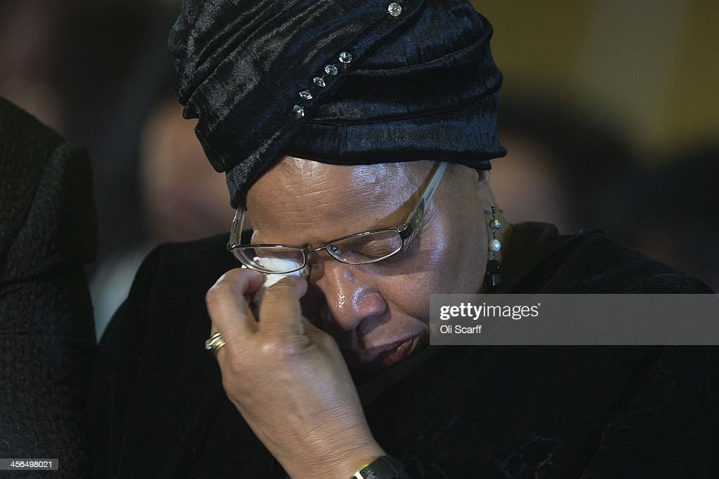 Graca Machel, the widow of Nelson Mandela, cries during an African National Congress (ANC) led alliance send off ceremony for former South African President Nelson Mandela at Waterkloof military airbase on December 14, 2013 in Pretoria, South Africa. The ANC held an official send off ceremony as the body of former South African President prepares to make one final journey to his hometown of Qunu for burial. Mr. Mandela passed away on the evening of December 5, 2013 at his home in Houghton at the age of 95. Mandela became South Africa's first black president in 1994 after spending 27 years in jail for his activism against apartheid in a racially-divided South Africa.