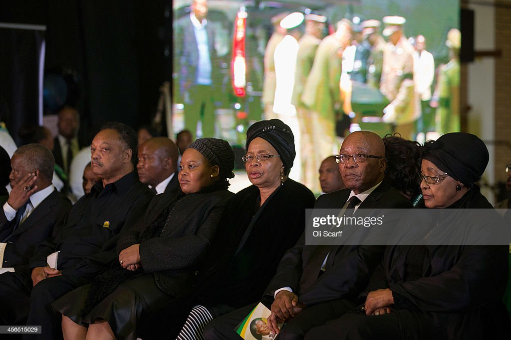 Graca Machel (C), widow of Nelson Mandela, South African President <a gi-track='captionPersonalityLinkClicked' href=/galleries/search?phrase=Jacob+Zuma&family=editorial&specificpeople=564982 ng-click='$event.stopPropagation()'>Jacob Zuma</a> (2nd R), <a gi-track='captionPersonalityLinkClicked' href=/galleries/search?phrase=Winnie+Mandela&family=editorial&specificpeople=212886 ng-click='$event.stopPropagation()'>Winnie Mandela</a> (R), former wife of Nelson Mandela, civil rights campaigner Jessie Jackson (2nd L), and former South African president <a gi-track='captionPersonalityLinkClicked' href=/galleries/search?phrase=Thabo+Mbeki&family=editorial&specificpeople=160910 ng-click='$event.stopPropagation()'>Thabo Mbeki</a> (L), listen to speeches during an African National Congress (ANC) led alliance send off ceremony for former South African President Nelson Mandela at Waterkloof military airbase on December 14, 2013 in Pretoria, South Africa. The ANC held an official send off ceremony as the body of former South African President prepares to make one final journey to his hometown of Qunu for burial. Mr. Mandela passed away on the evening of December 5, 2013 at his home in Houghton at the age of 95. Mandela became South Africa's first black president in 1994 after spending 27 years in jail for his activism against apartheid in a racially-divided South Africa.