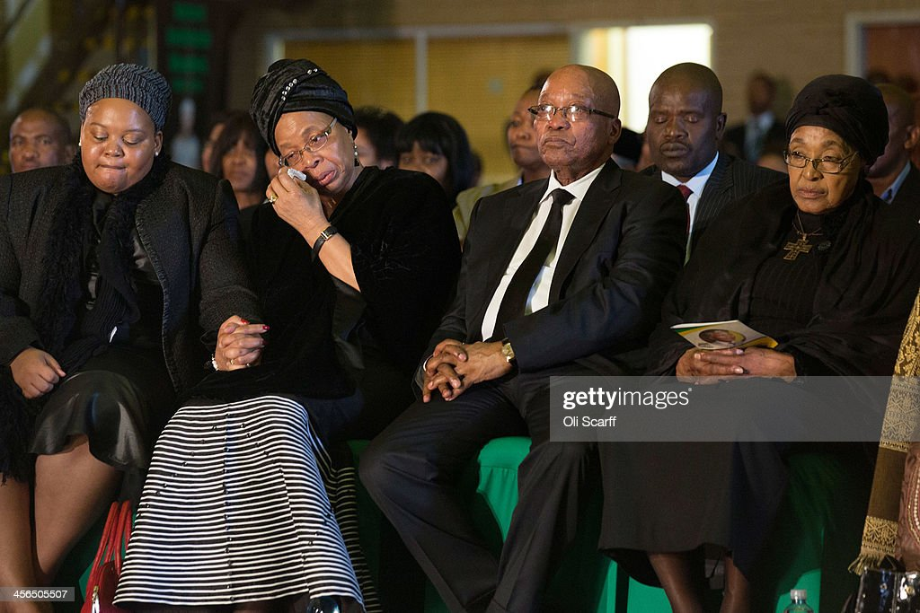 Graca Machel (2nd L), widow of Nelson Mandela, South Africa's President <a gi-track='captionPersonalityLinkClicked' href=/galleries/search?phrase=Jacob+Zuma&family=editorial&specificpeople=564982 ng-click='$event.stopPropagation()'>Jacob Zuma</a> (2nd R) and former wife of Nelson Mandela, <a gi-track='captionPersonalityLinkClicked' href=/galleries/search?phrase=Winnie+Mandela&family=editorial&specificpeople=212886 ng-click='$event.stopPropagation()'>Winnie Mandela</a> (R) listen to speeches during an African National Congress (ANC) led alliance send off ceremony for former South African President Nelson Mandela at Waterkloof military airbase on December 14, 2013 in Pretoria, South Africa. The ANC held an official send off ceremony as the body of former South African President prepares to make one final journey to his hometown of Qunu for burial. Mr. Mandela passed away on the evening of December 5, 2013 at his home in Houghton at the age of 95. Mandela became South Africa's first black president in 1994 after spending 27 years in jail for his activism against apartheid in a racially-divided South Africa.