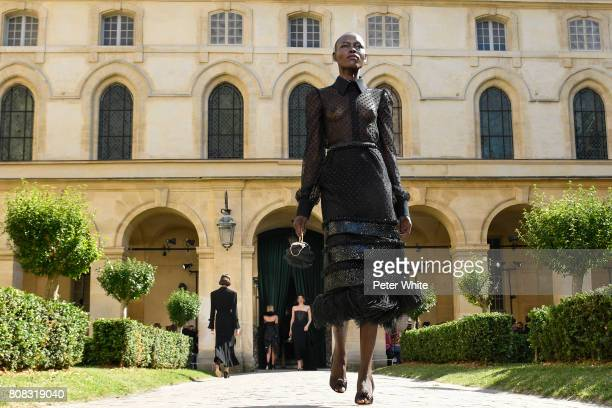 Grace Bol walks the runway during the Ulyana Sergeenko Haute Couture Fall/Winter 20172018 show as part of Haute Couture Paris Fashion Week on July 4...