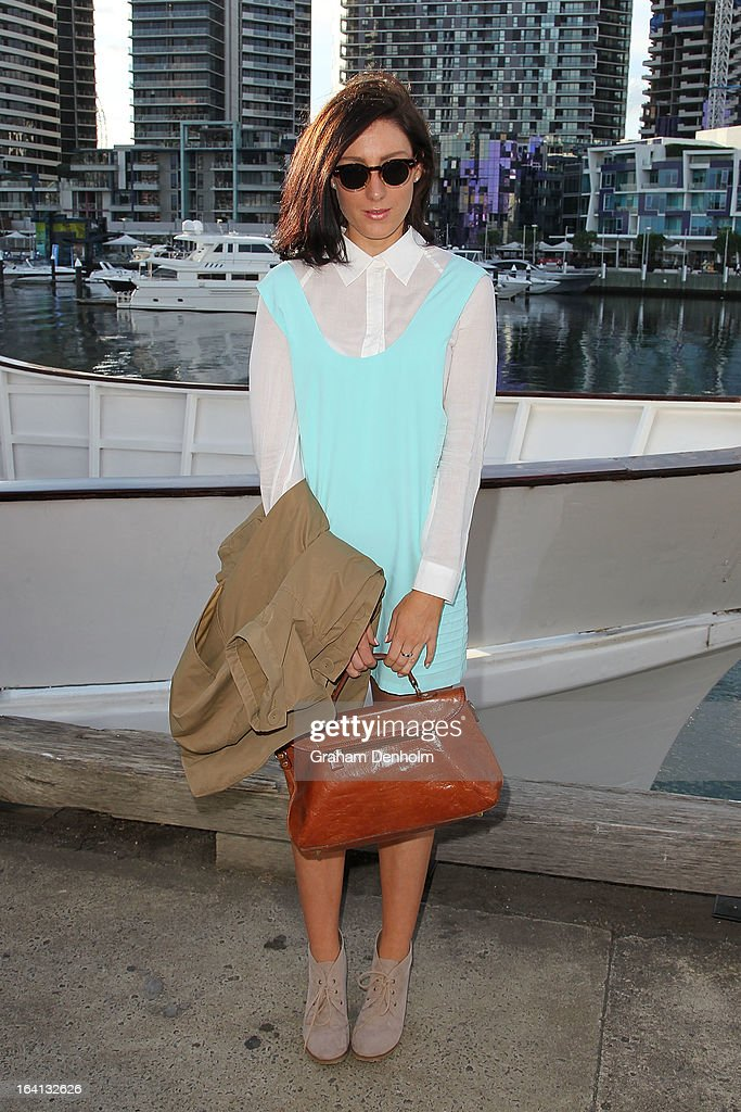 Grace Cobb wears a shirt and dress by Finders Keepers, coat by Cue and a vintage bag on day three at L'Oreal Melbourne Fashion Festival on March 20, 2013 in Melbourne, Australia.