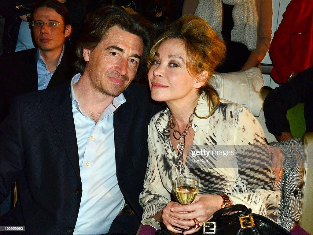 Grace de Capitani (R) and Jean Pierre Jacquin attend 'Le Salon Sur L'Eau Marrezziani And Le Cap Swimming Suits' Show Cocktail At Quai Marcel Dassault on April 18, 2013 in Suresnes, France.