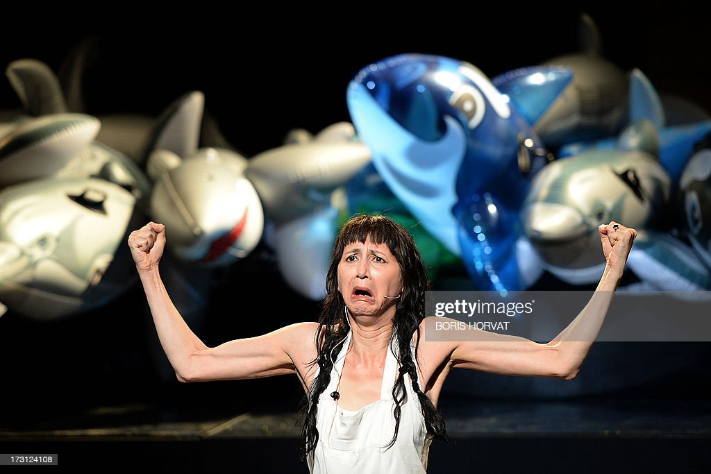 Grace Ellen Barkey performs a play written and directed Belgian Jan Lauwers 'Place du marché 76' on July 7, 2013 in Avignon, during the 67th International Theatre festival.