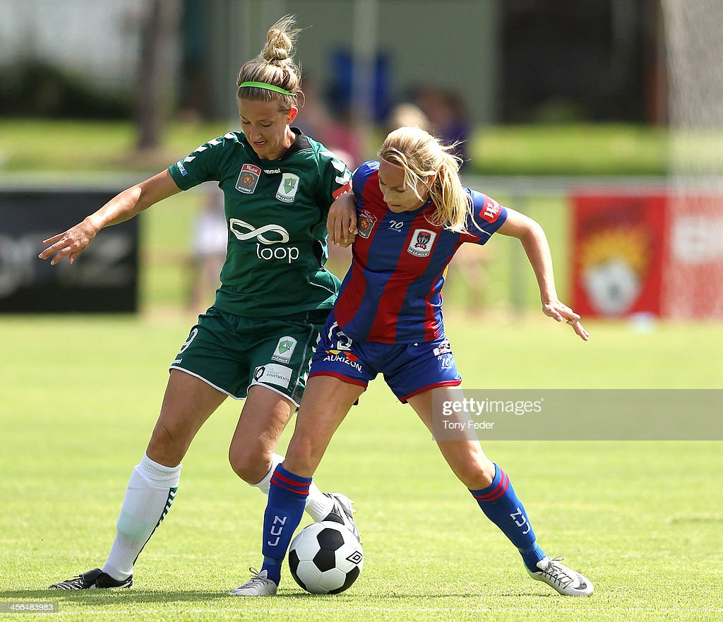 Grace Gill of Canberra United contests the ball against Hannah Beard of the Jets during the round five W-League match between the Newcastle Jets and Canberra United at Wanderers Oval on December 14, 2013 in Newcastle, Australia.