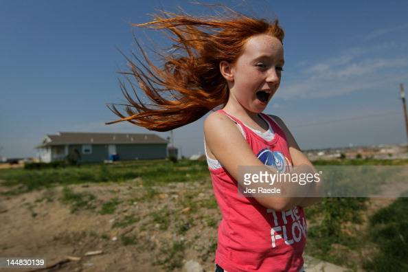 Grace Goebel plays outside of the new Habitat for Humanity home of her parents that was built on the spot of a home that had been destroyed after a...