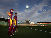 Grace Harris and Beth Mooney of the Queensland Fire prepare to walk out to bat during the WT20 match between Tasmania and Queensland Aurora Stadium...