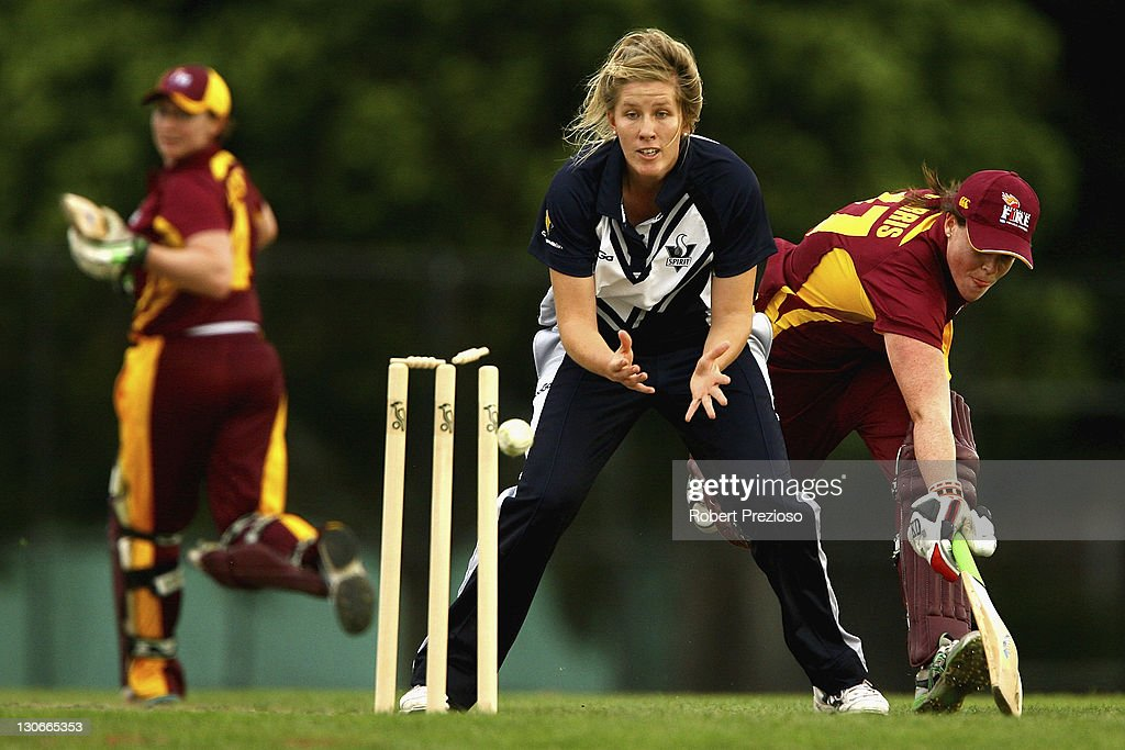 Grace Harris of the Fire is run out by Julie Hunter of the Spirit with a direct throw during the women's Twenty20 match between the Victoria Spirit...