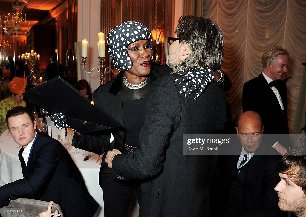 Grace Jones (L) and David Downton attend the Isabella Blow: Fashion Galore! charity dinner hosted by the Isabella Blow Foundation at Claridges Hotel on November 19, 2013 in London, England.
