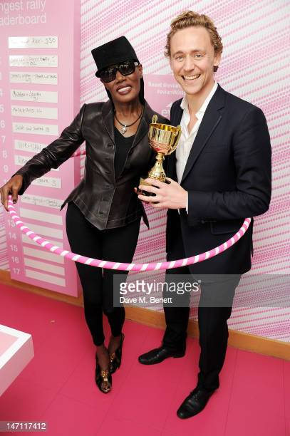 Grace Jones and Tom Hiddleston attend the evian 'Live young' VIP Suite at Wimbledon on June 25 2012 in London England