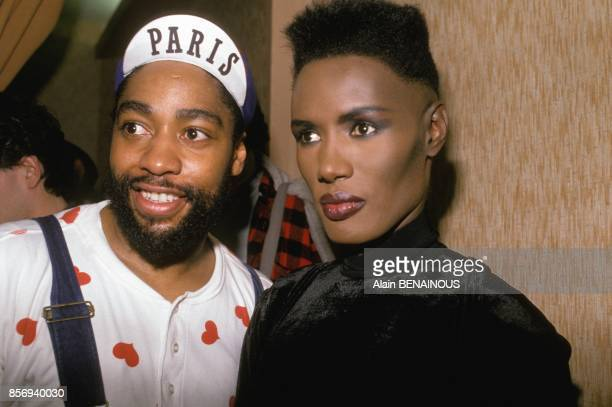 Grace Jones in her dressing room with fashion designer Patrick Kelly at Olympia music hall on December 02 1988 in Paris France