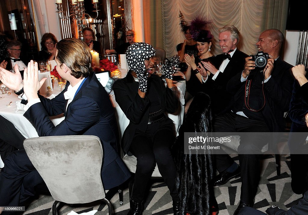 Grace Jones, Kim Murdoch, Philip Treacy and Michael Roberts attend the Isabella Blow: Fashion Galore! charity dinner hosted by the Isabella Blow Foundation at Claridges Hotel on November 19, 2013 in London, England.